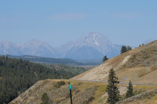 "Just when you think you've been in some significant mountains, the VERY significant mountains come into view - THE GRAND TETONS.  My loyal follower in France, a Border collie named BLOG, has provided information that TETONS translates into ""nipples.""  I am not making this up!"
